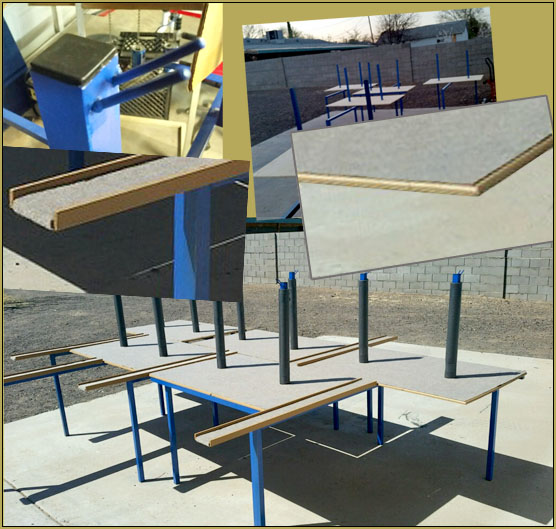 Beautiful job, guys... painted steel flight stands with plastic end-caps on the tubing, router-rounded edges on the tables, and a layer of carpet... and Charlie included little pegs for hanging a pilot's transmitter. Awesome!