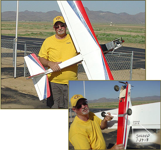 "Paul ""Pauly"" Forsyth proudly holds his trainer after his solo flight... Well done!"