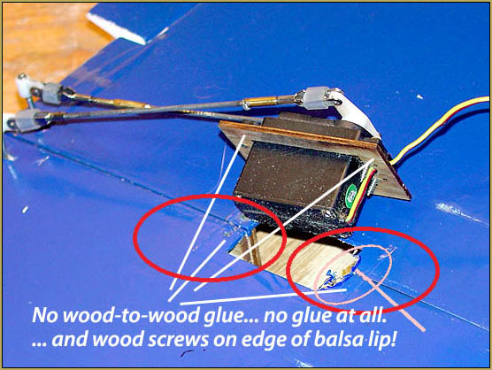 No glue and only a couple of wood screws through the edge of the balsa lip.